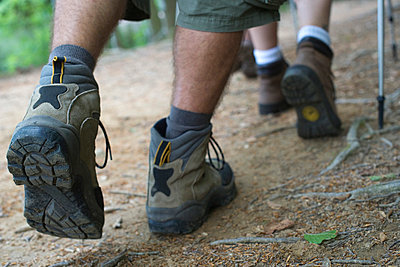 Hikers walking on path, close-up of feet - p62321473f by Frederic Cirou