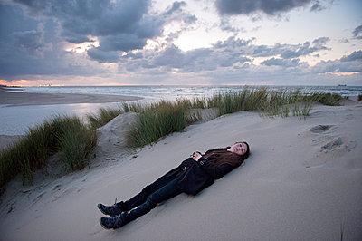 Resting in dune landscape - p896m834841 by Sabine Joosten