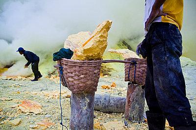 Sulphur miners at the Kawah Ijen Sulphur Mines in East Java - p934m1022325 by Dominic Blewett