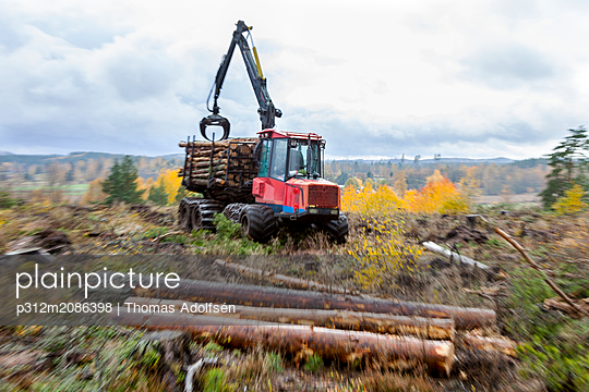 Forest machine at work - p312m2086398 by Thomas Adolfsén