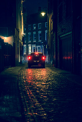 Car at the end of cobblestoned street - p1170m1516275 by Bjanka Kadic