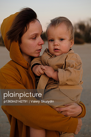 Woman and her son on beach - p1363m2142791 by Valery Skurydin