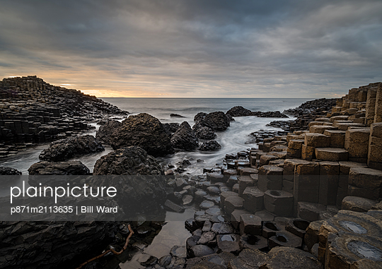 Giant's Causeway at sunset, UNESCO World Heritage Site, County Antrim, Northern Ireland, United Kingdom - p871m2113635 by Bill Ward