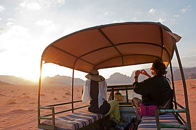Travelling by jeep in the Wadi Rum, Jordan - p6521958 by Paul Harris photography