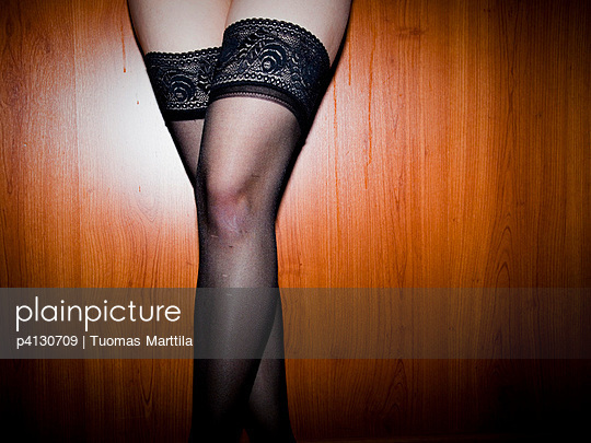 Woman with black stockings - p4130709 by Tuomas Marttila