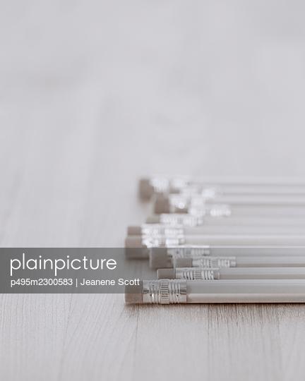 Row of pencils on wooden table - p495m2300583 by Jeanene Scott