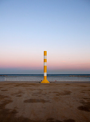 Post on the beach at sunset in Barcelona - p1072m829083 by Joan Seculi