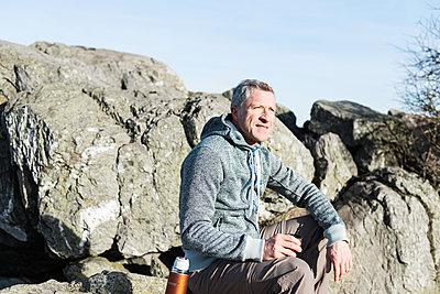 Mountain hiker takes a break - p1142m1445227 by Runar Lind