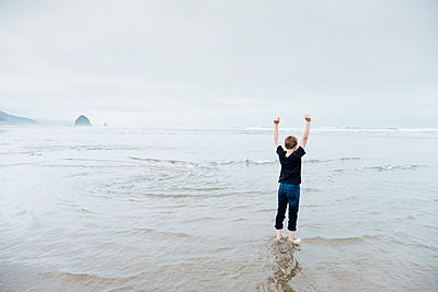 Playing at Cannon Beach - p1262m1440874 by Maryanne Gobble