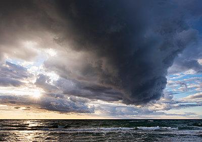 Germany, Mecklenburg-Western Pomerania, rain clouds over Baltic Sea - p300m1101234f by Martin Siepmann
