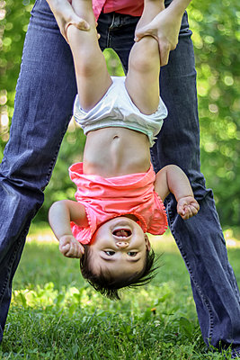 Mother and Daughter play in yard  - p1019m1425956 by Stephen Carroll