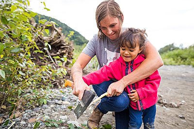Toddler helping mother make roasting stick - p1166m2201992 by Christopher Kimmel / Alpine Edge Photography