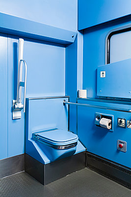 A bathroom on a train, painted a vibrant blue color - p1094m900224 by Patrick Strattner