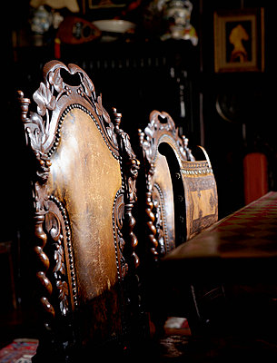 Carved chair backs at dining table of Grade I listed Elizabethan manor house in Kent  - p349m789798 by Brent Darby
