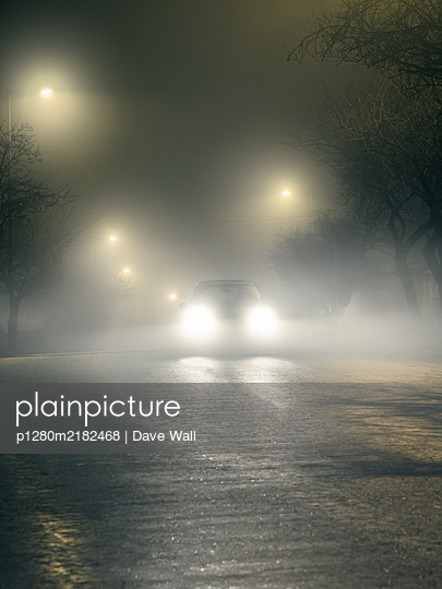 Car in the fog at night - p1280m2182468 by Dave Wall