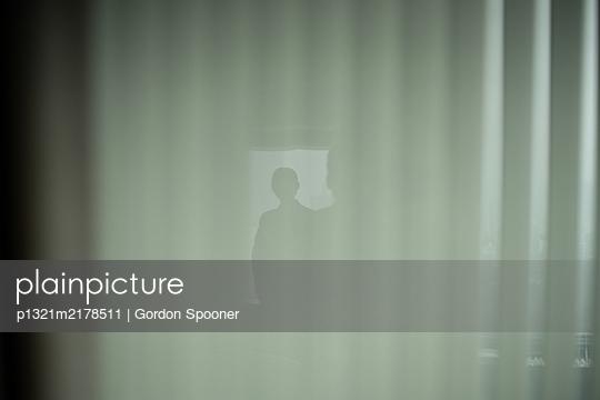 Woman window reflection - p1321m2178511 by Gordon Spooner