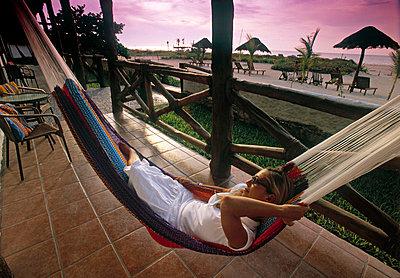 Woman in hammock - p6510597 by John Coletti photography