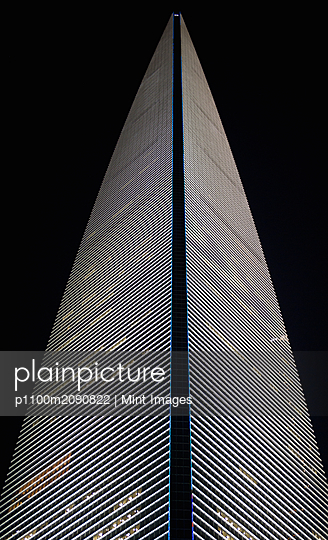 Skyscraper Building at Night - p1100m2090822 by Mint Images