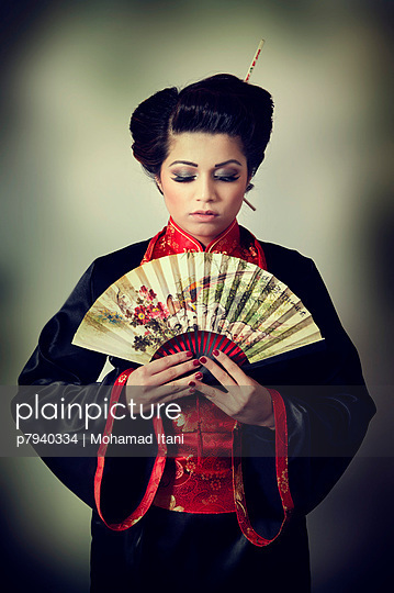 Geisha with a fan - p7940334 by Mohamad Itani