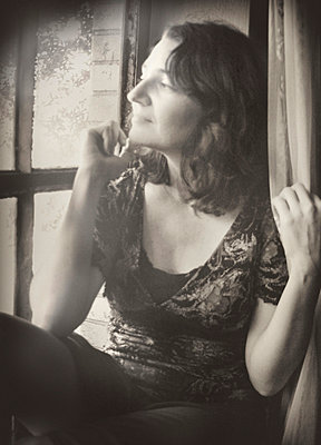 Profile of Beautiful Woman Gazing out Window - p1072m857320f by Michelle Kelly