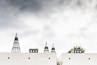 Modern building with pointed towers - p401m2219847 by Frank Baquet