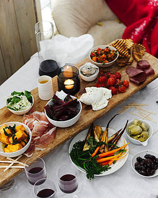 Dining table selection of antipasto with red wine - p429m839042 by BRETT STEVENS