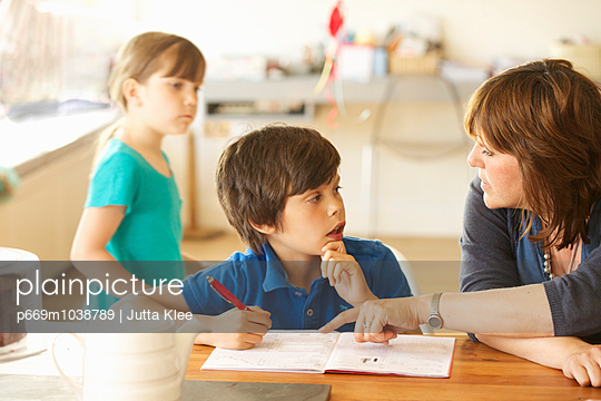 Mother and Son Doing Homework - p669m1038789 by Jutta Klee photography