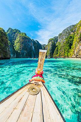 Ao Pileh (Pileh Lagoon), Ko Phi Phi Leh, Krabi Province, Thailand. Wooden bow of a long tail boat in turquoise waters. - p651m2032810 by Marco Bottigelli