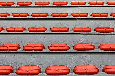 Empty stadium seating, Marcel-Saupin Stadium, Nantes, France - p675m922730 by Christian Zachariasen