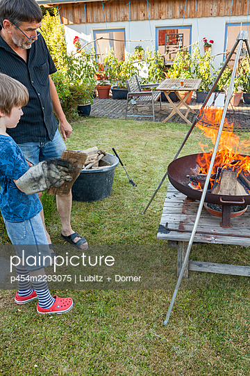 Strating a fire together - p454m2293075 by Lubitz + Dorner