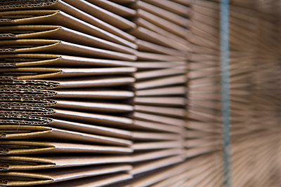 Close up of cardboard stock warehouse - p429m942794f by Judith Haeusler