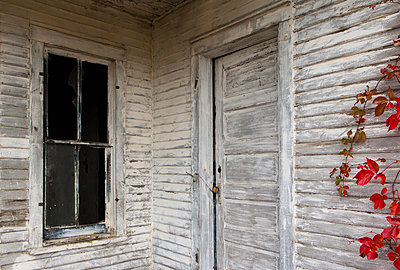 Rustic door, siding and window of wooden house - p555m1459349 by Chris Clor