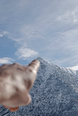 Pointing at mountain peak - p260m1161237 by Frank Dan Hofacker
