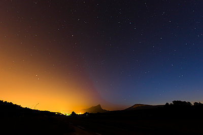 Light pollution under starry sky - p829m1110844 by Régis Domergue
