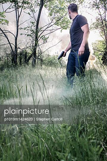 Armed man in a field - p1019m1424623 by Stephen Carroll