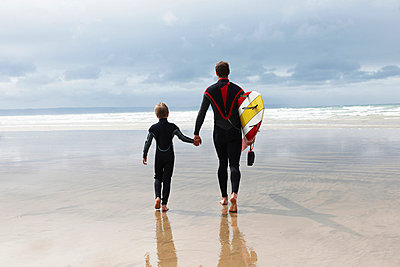 Father and Son going surfing - p42911810f by Adie Bush