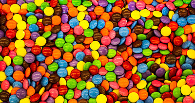 Multi-coloured candy-coated chocolate candies - p442m2039456 by David Chapman