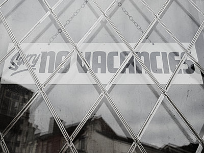 Sorry No Vacancies, sign, folding grille at the window - p1280m2291209 by Dave Wall