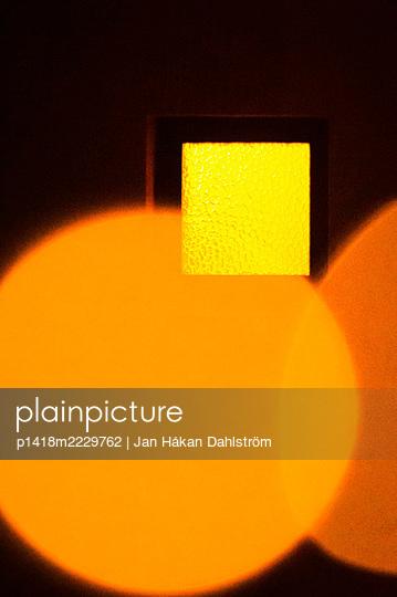 Square bathroom window and orange circles - p1418m2229762 by Jan Håkan Dahlström