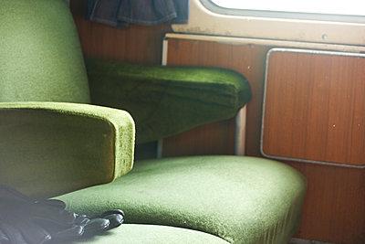 Train ride on a green velvet seat - p1513m2039175 by ESTELLE FENECH