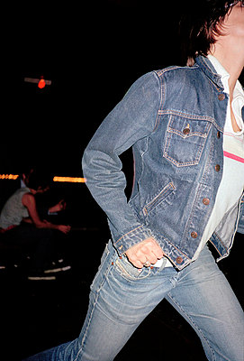 woman in jeans walking - p3880245 by Jet photography