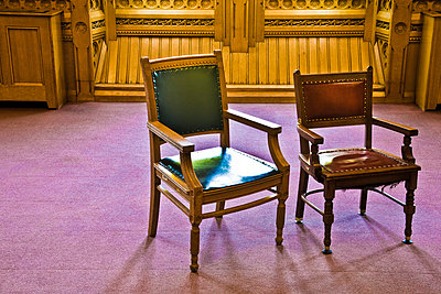 Two empty old-fashioned style business chairs - p6070658 by Peter Glass