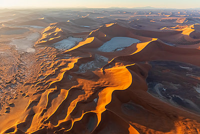 Africa, Namibia, Namib desert, Namib-Naukluft National Park, Aerial view of desert dunes, Dead Vlei and 'Big Daddy' in the morning light - p300m2023705 by Fotofeeling