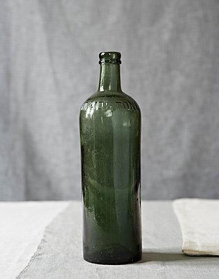 Vintage green bottle - p349m896280 by Jon Day