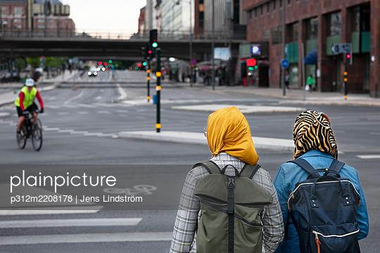 Female friends walking together - p312m2208178 by Jens Lindström