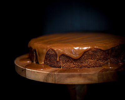 Ginger Caramel Cheesecake Against a Black Background - p1166m2169223 by Cavan Images