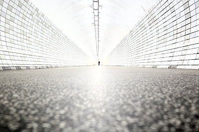 Pedestrian in a tunnel - p1258m1165809 by Peter Hamel