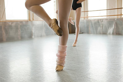 Two ballet dancers warming up - p9240147 by Carey Kirkella