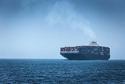 Spain, Andalusia, Tarifa, Cargo ship - p300m980741f by Sebastian Kanzler
