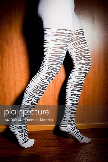 Woman with zebra stockings - p4130714 by Tuomas Marttila
